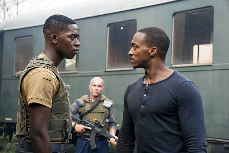 OUTSIDE THE WIRE, Damson Idris as Harp, Anthony Mackie as Leo, in OUTSIDE THE WIRE. Cr. Jonathan Prime/NETFLIX © 2020